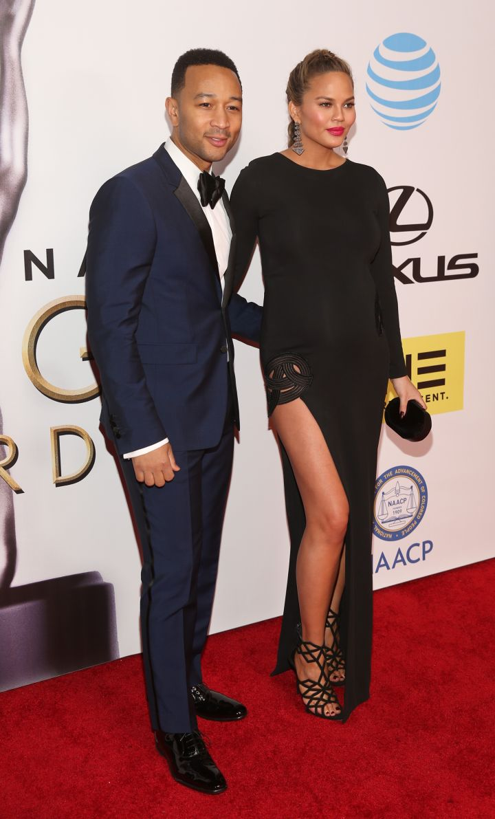 John Legend accompanies Chrissy on the red carpet.