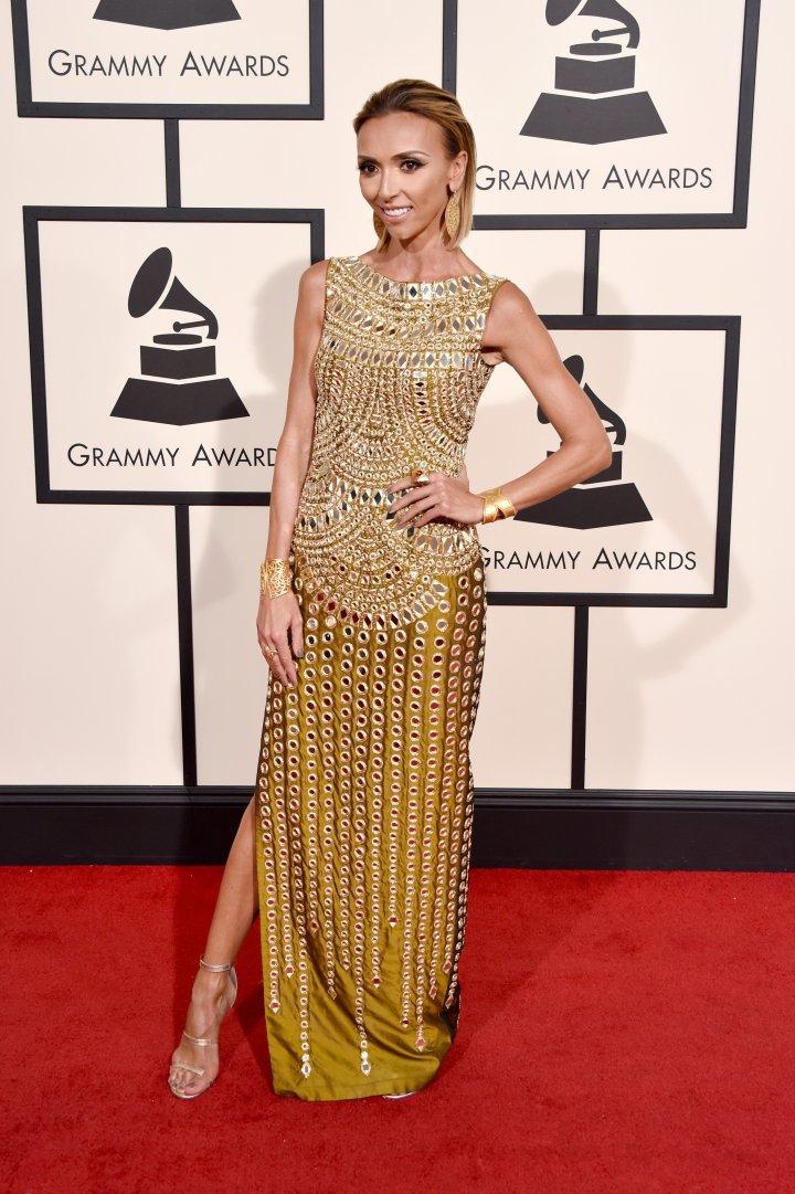 Giuliana Rancic glowing in gold.