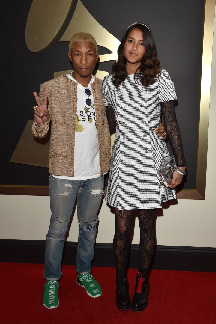 Pharrell with his wife, Helen. Are you feeling his platinum blonde 'do?