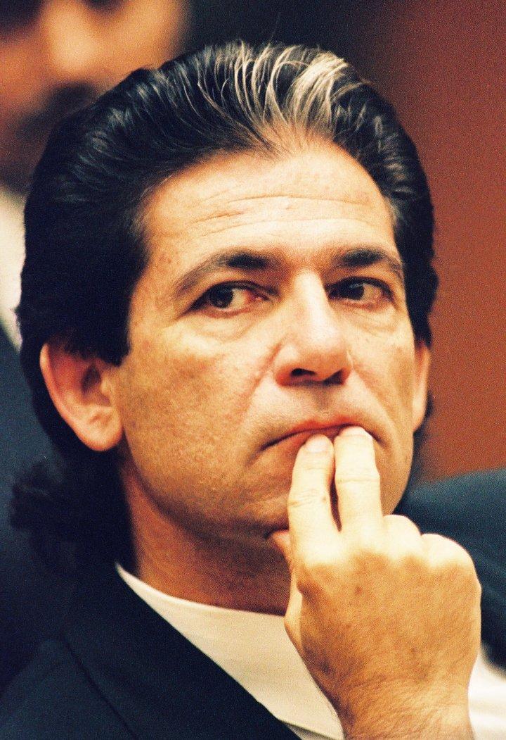 Robert Kardashian sits through trial.