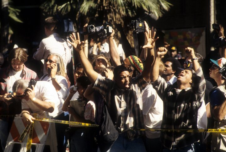 The crowd cheers after hearing the verdict on October 3rd, 1995.