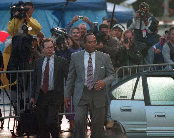 ME.OJ.for mika.1122.RG –– O.J. Simpson leaves the Santa Monica Courthouse after a day of testifying