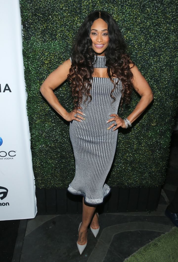 Tami Roman posed for the cameras in stripes.