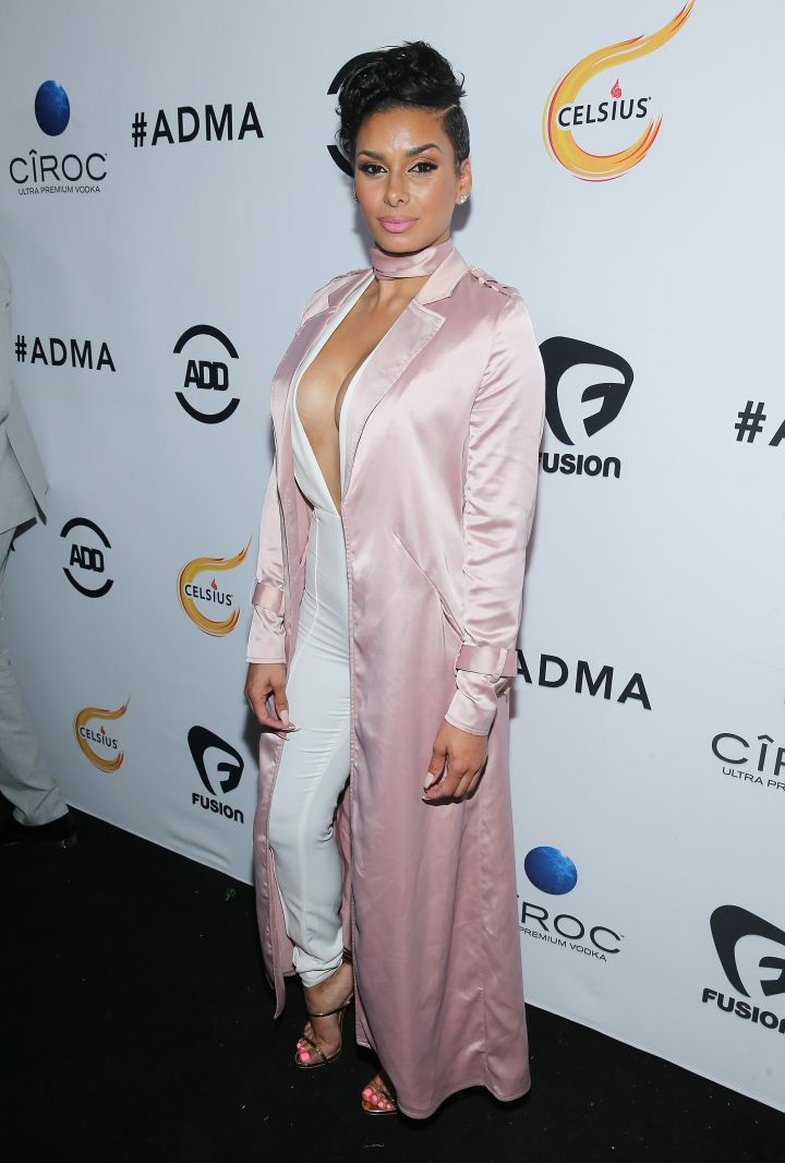 Pretty in pink. Laura Govan paired a white jumpsuit with a satin pink overcoat.