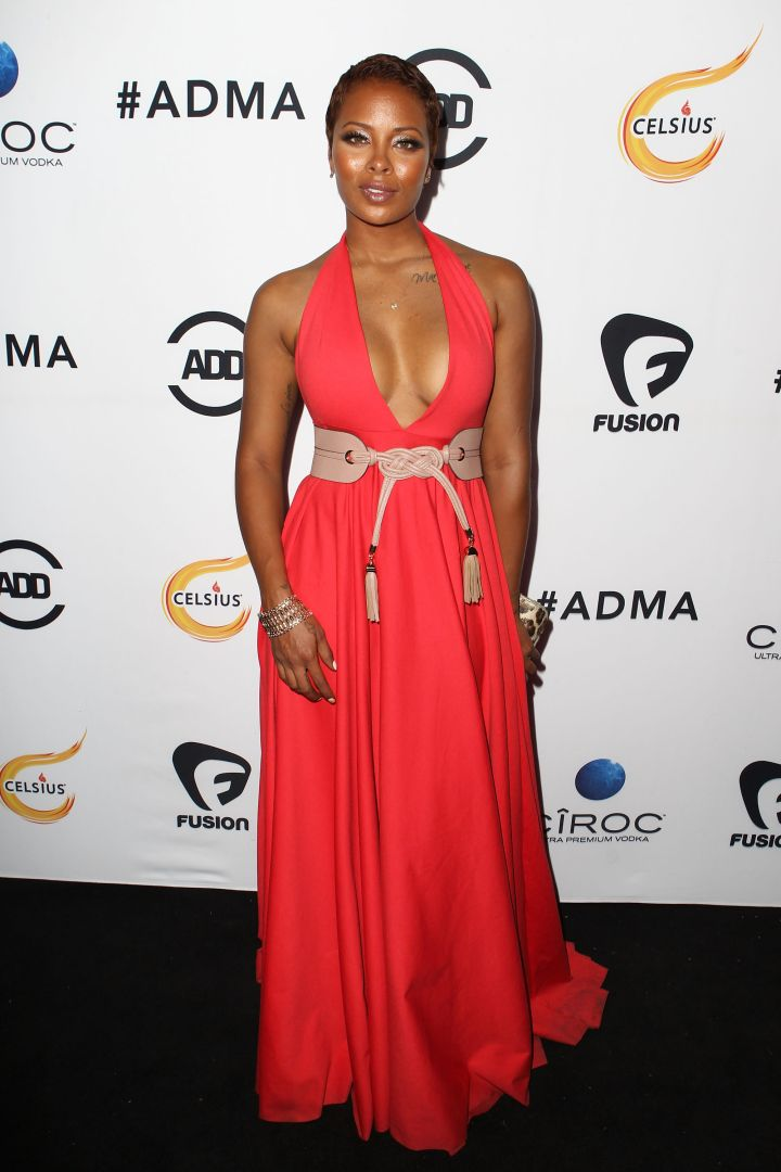 Eva Marcille's skin was glowing in a coral gown with a halter neckline.