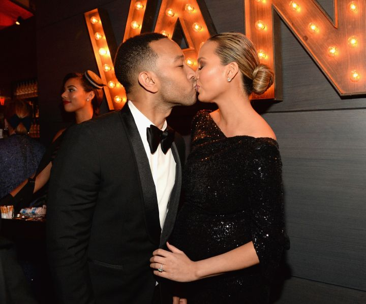Smooches. Chrissy Teigen couldn't make a face this time as her husband John Legend planted a wet one on her.