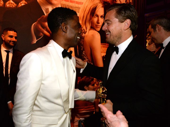 Chris Rock talks with the night's big winner, Leonardo DiCaprio.