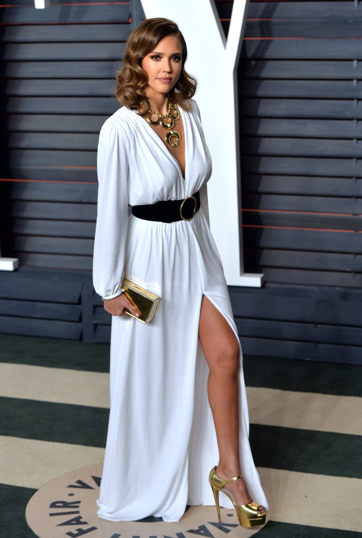 The beautiful Jessica Alba appeared angelic in a flowing, white gown accessorized with a black belt and statement necklace.
