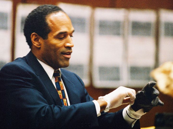 O.J. tries on a glove that was used in the murder of his ex-wife.