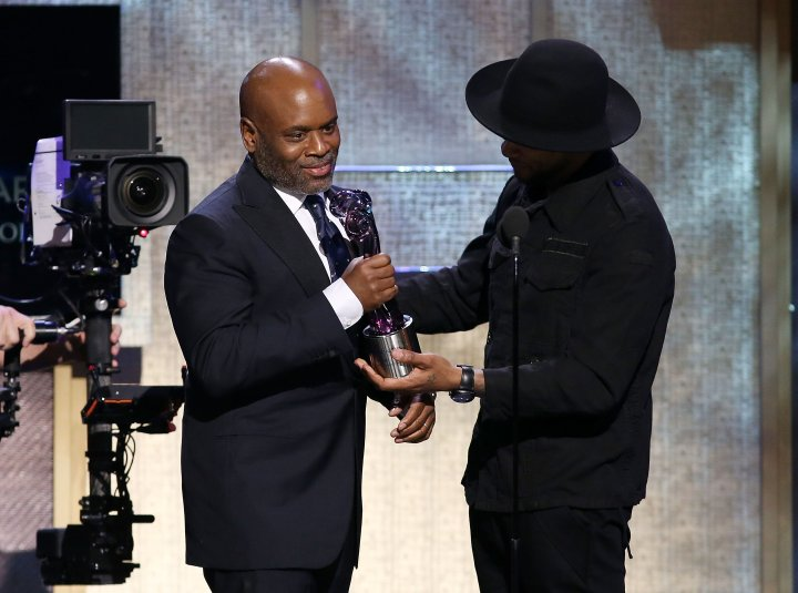 L.A Reid accepting the Business of Entertainment Award, presented by Usher