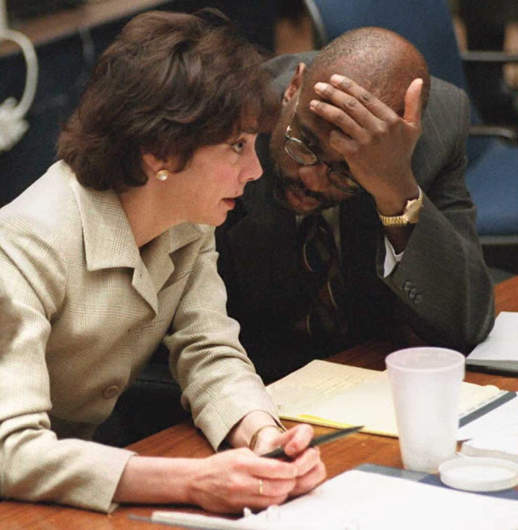 Prosecutors Marcia Clark (L) and Christopher Darde