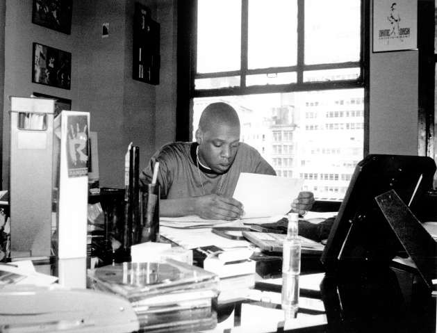 Jay Z Looks Over Some Documents