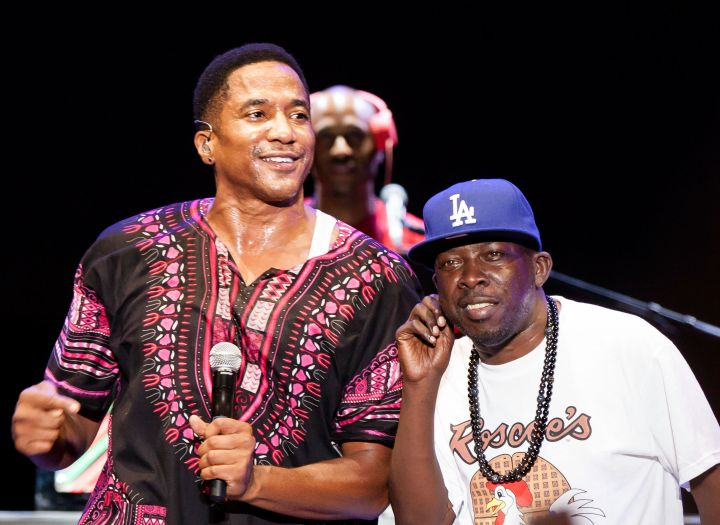 Phife Dawg and Q-Tip of A Tribe Called Quest perform at Univision Radio's H2O music festival at Los Angeles state historic park on August 17, 2013.