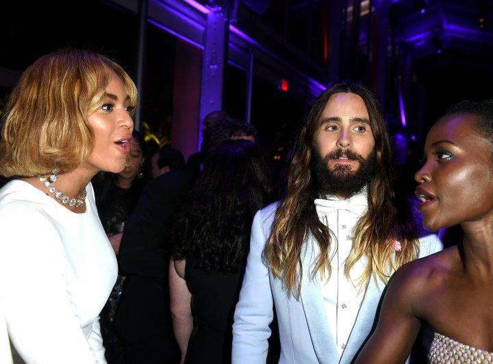 Beyonce shares a stylish moment with Lupita Nyong'o.