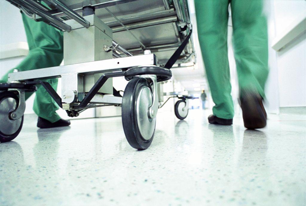 Gurney being rushed through hospital corridor (Enhancement)