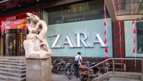 A parking corner for bikes outside a ZARA shop. With the...