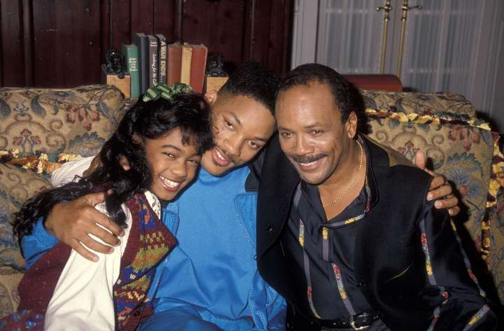 1990: Tatyana leans in for a photo with Will Smith and Quincy Jones.