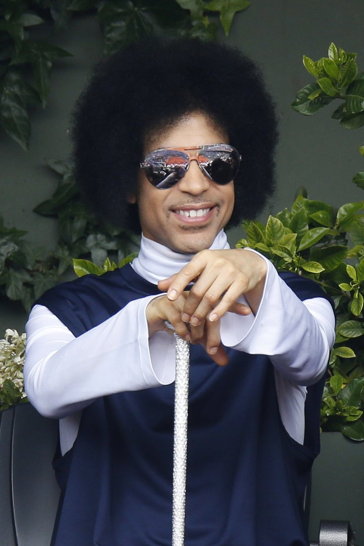US singer Prince attends the French Tennis Open round of sixteen match between Spain's Rafael Nadal and Serbia's Dusan Lajovic at the Roland Garros stadium in Paris on June 2, 2014.