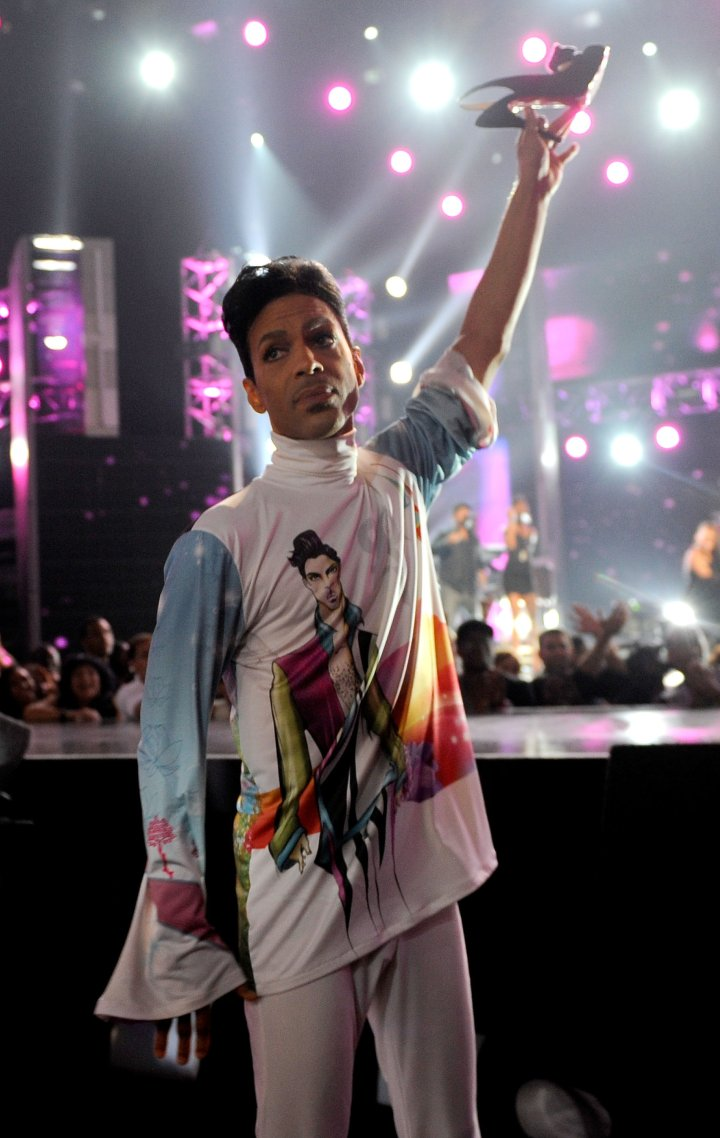 Musician Prince holds up singer Patti LaBelle's shoe during her performance at the 2010 BET Awards held at the Shrine Auditorium on June 27, 2010.