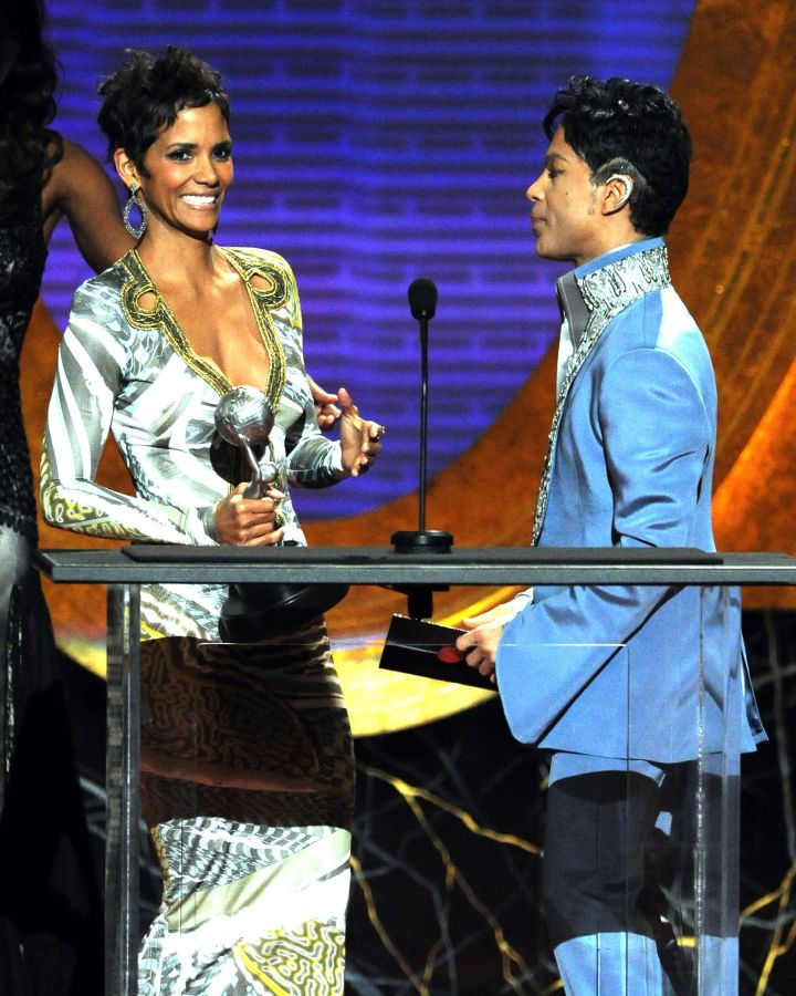 Prince presents an award to Halle Berry 42nd Annual NAACP Image Awards