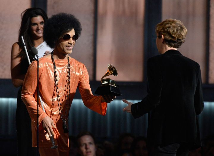 Prince presents an award to Beck at the 57th Annual GRAMMY Awards