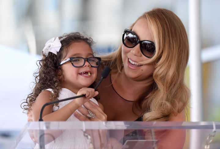 Mariah laughs with daughter Monroe