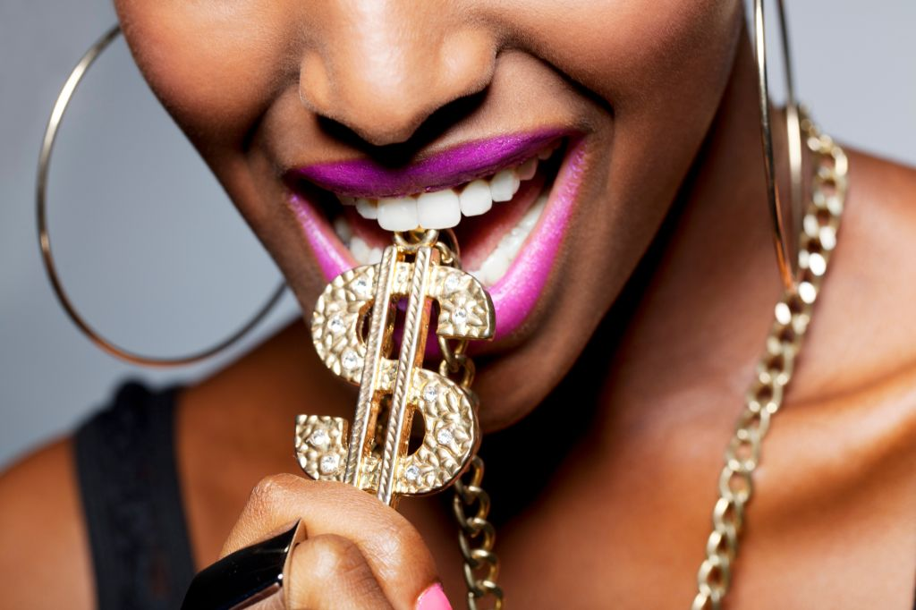Close Up of Woman's Mouth with Dollar