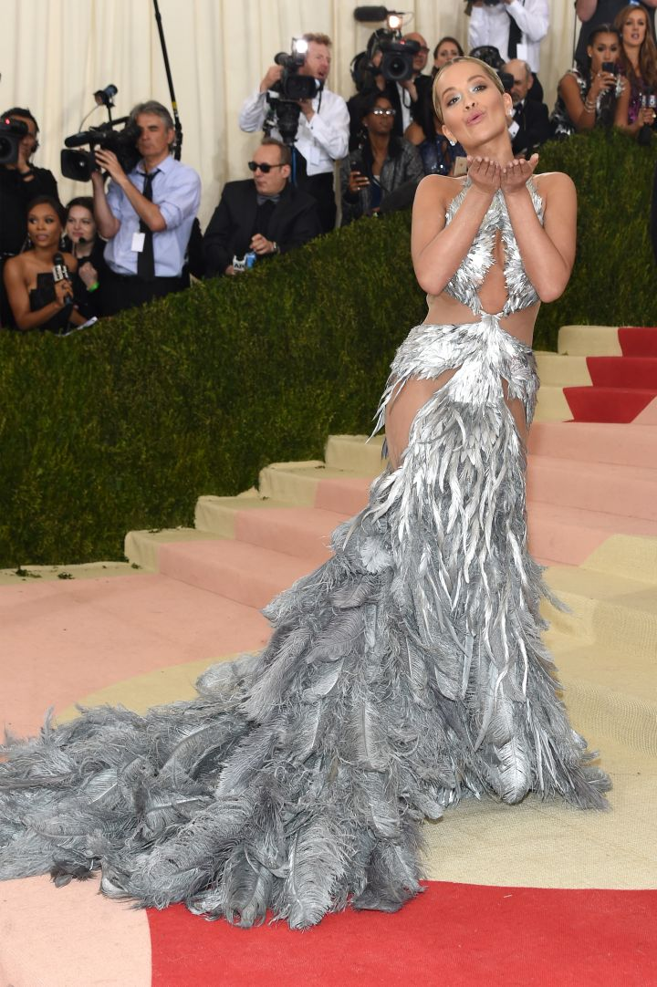 Rita Ora's feather and sheer gown by Vera Wang is nothing short of epic.