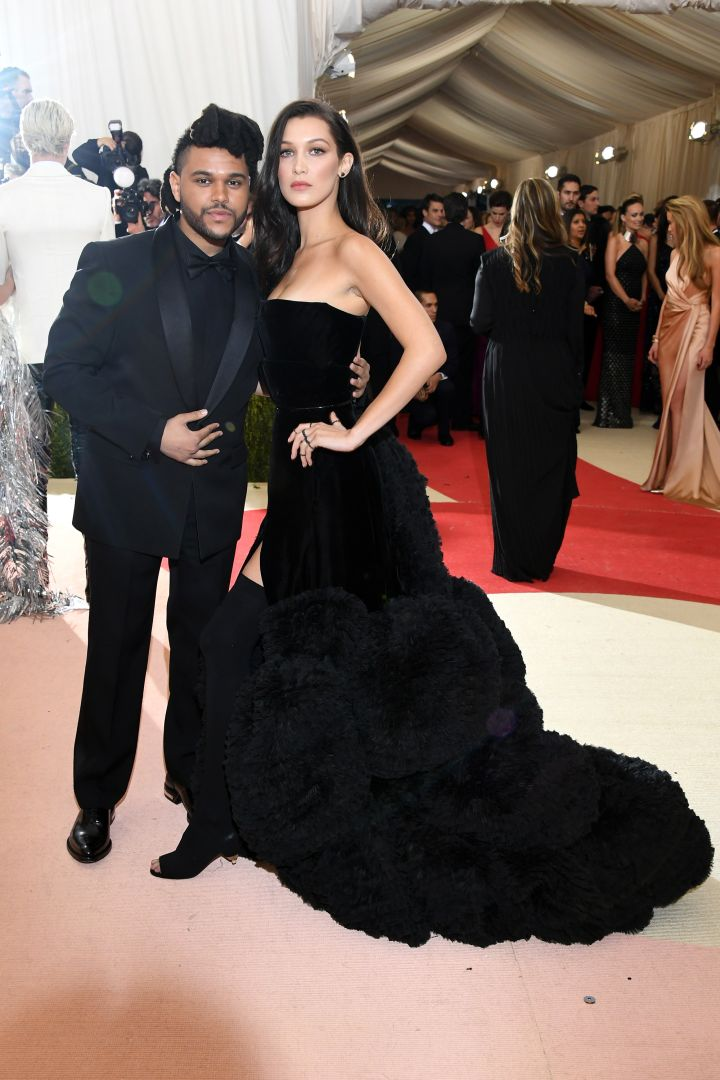 The Weeknd and Bella Hadid arrive in all black, per usual.