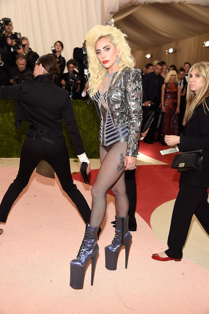 Lady Gaga goes for a bold look in sky-high boots.