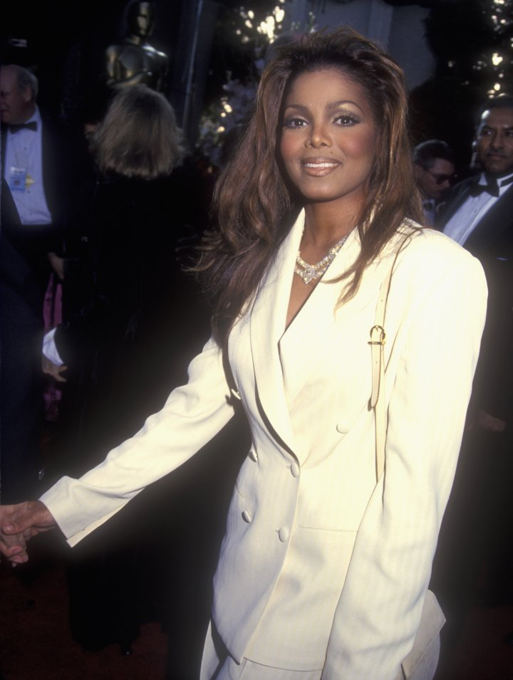 Janet gave the masculine pantsuit a feminine touch.