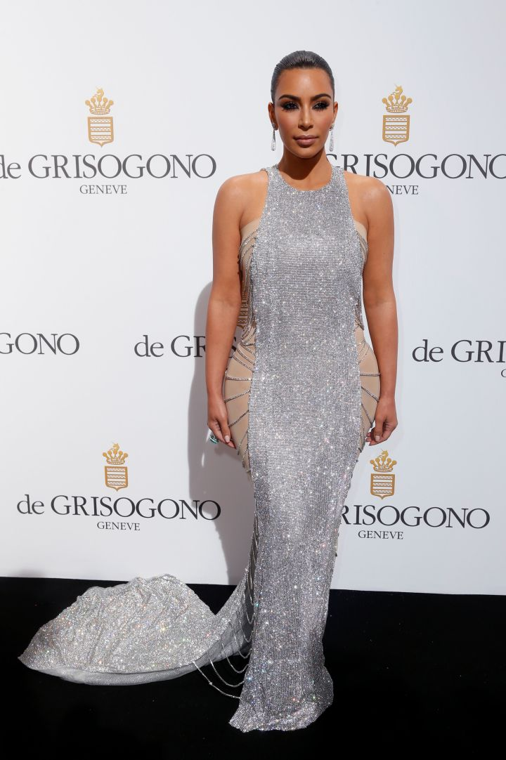 Kim Kardashian's snapback game is too strong. She posed in a gown by Lanyu Couture.
