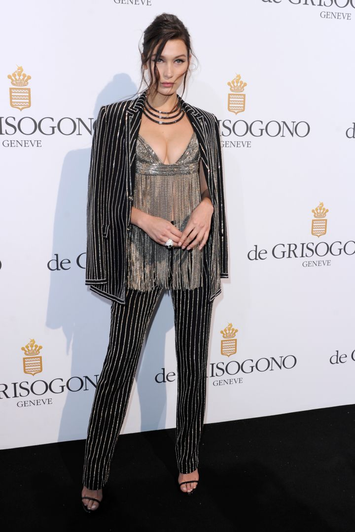 Bella Hadid wore a fringed top and matching pantsuit set.