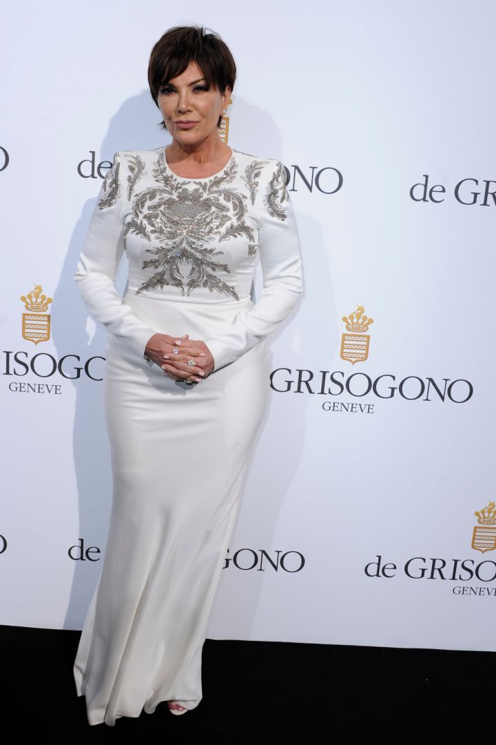 Kris Jenner posed alongside Kim Kardashian in a white gown with sparkling detail by Alexander McQueen.