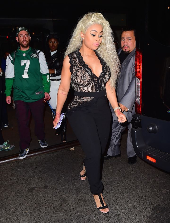 Blac Chyna steps out in a semi-sheer black jumpsuit.
