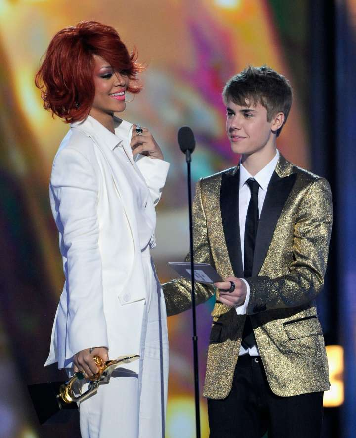 Pre-bad boy behavior Justin Bieber presenting an award to a then red-haired Rihanna in 2011.