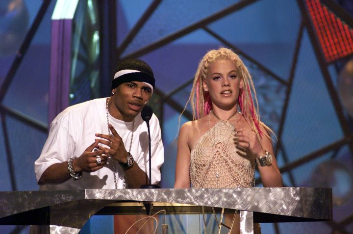 Nelly rocking two headbands and Pink with her pink hair…this photo screams 2001.