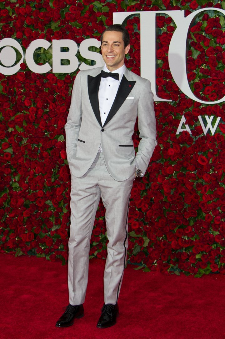 Actor Zachary Levi in a gray suit.