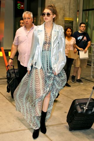 Gigi Hadid wears a See Through Dress & Teal Jacket while arriving in Toronto for iHeartRadio MMVAs