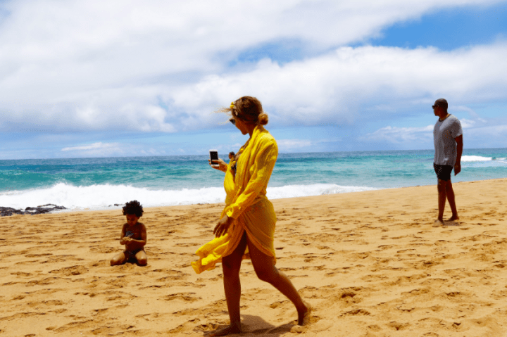 Mama Bey catches an adorable moment on her iPhone.