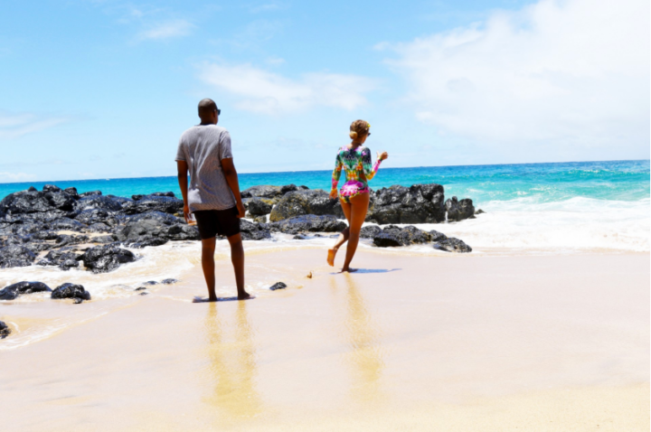 Bey takes a walk on the sand with her hubby.
