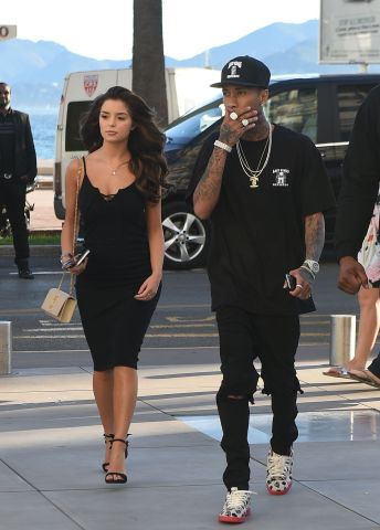 Tyga & Demi Rose Mawby are seen out shopping in Cannes at Saint Laurent, Tyga treated his new girlfriend to some new shoes and dresses, Demi was seen inside the shop for 2 hours trying clothes on.