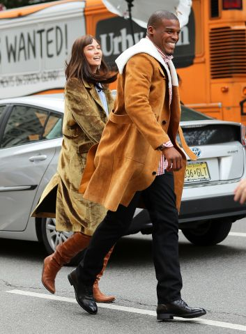 Cam Newton and Karlie Kloss run inbetween cars on a Vogue photoshoot in New York