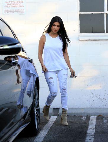 Kourtney Kardashian wearing all white was spotted leaving a studio in Van Nuys.