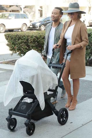 Chrissy Teigan and John Legend shopping and pushing stroller through Beverly Hills, CA