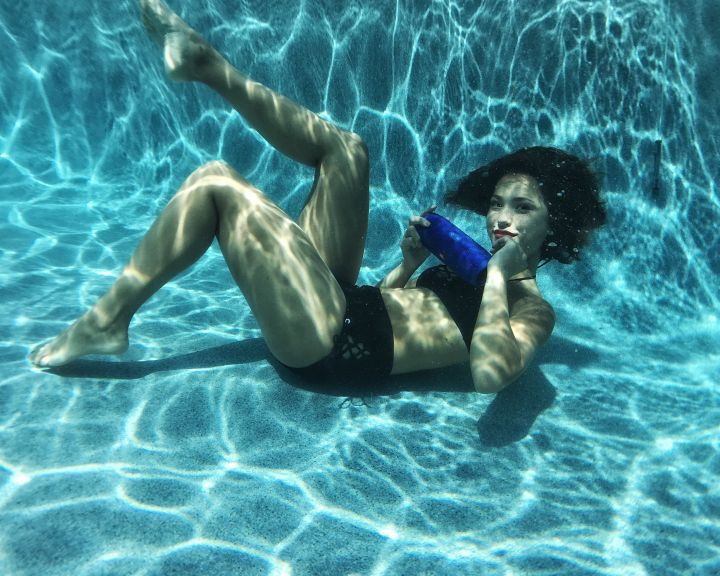 """Models Swimming With JBL's New """"Charge 3"""" Waterproof Portable Speaker."""