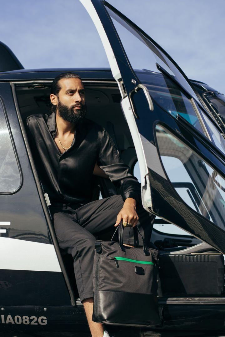 Model Sports His Heineken & TUMI Travel Bag In Miami
