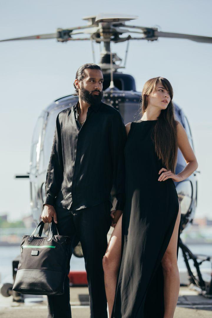 Models Sporting Their Heineken & TUMI Travel Bags
