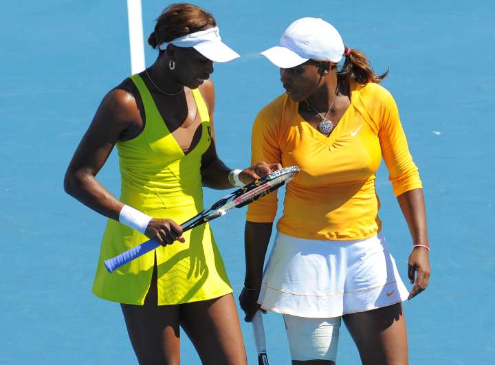 Venus rocks a double slit tennis dress while playing with her sister at the 2010 Australian Open