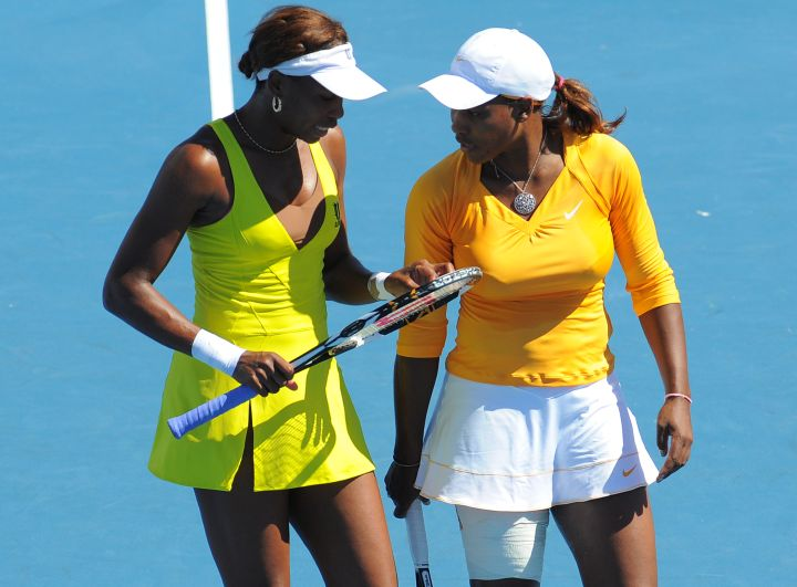 Venus rocks a double slit tennis dress while playing with her sister at the 2010 Australian Open.